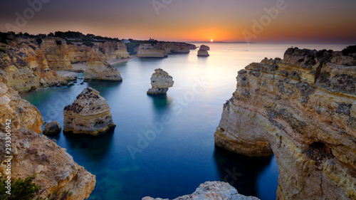 Foto op Plexiglas Cappuccino Sunrise over Faro and the Algarve from near Plaia da Marinha, Portugal