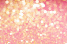 Abstract Composition. Blurred Photo Of Glitter With Beautiful Bokeh In Pink And Gold. Defocused Light.