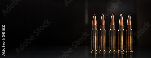 Bullet isolated on black background with reflexion Wallpaper Mural