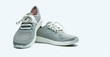canvas print picture - A pair of grey shoes on white background. Comfortable shoes with pore. Breathable rubber shoes. Footwear.