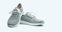 A Pair Of Grey Shoes On White Background. Comfortable Shoes With Pore. Breathable Rubber Shoes. Footwear.
