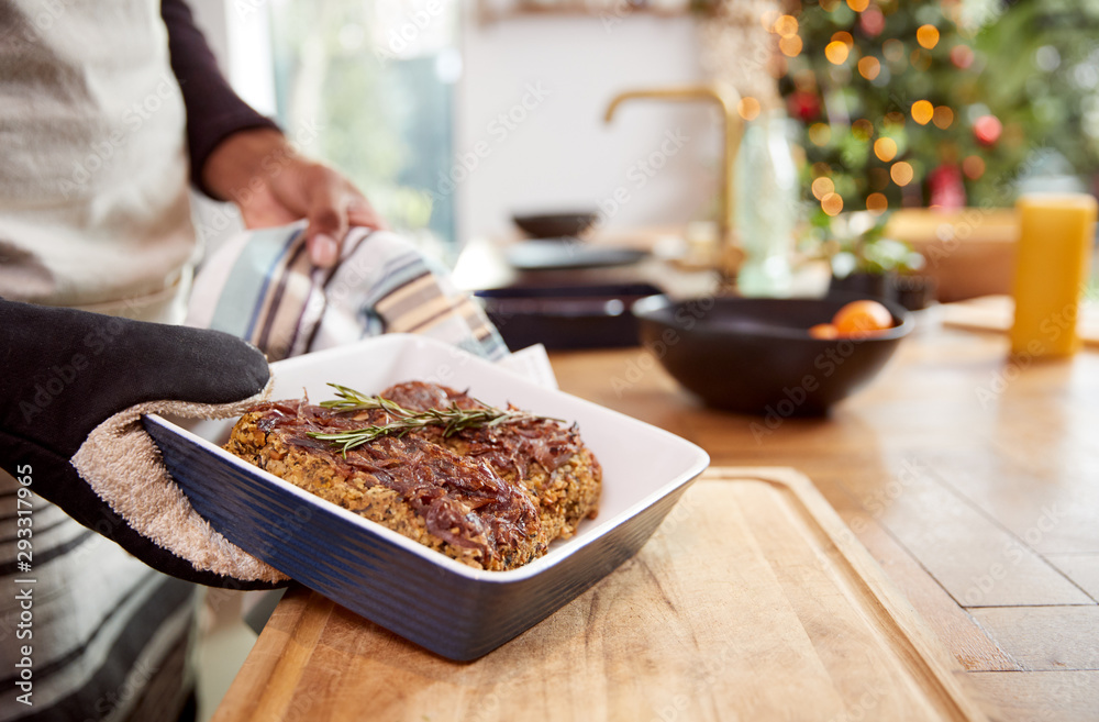 Fototapety, obrazy: Close Up Of Man Taking Vegetarian Nut Roast Out Of Oven For Christmas Dinner