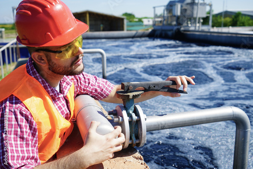 Obraz na plátne  An engineer controlling a quality of water ,aerated activated sludge tank at a w