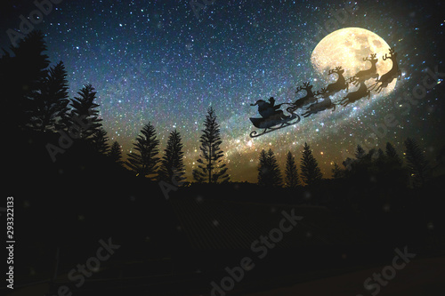 Obraz noise pic,Christmas,Merry Christmas and happy holidays! Santa Claus flying in his sleigh against moon sky.  - fototapety do salonu