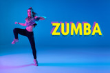Young girl dancing Zumba. Neon light and color background. Poster design. Dance competitions. Dance Studio.