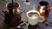 Coffee Cup With Freshly Brewed Coffee On An Old Vintage Table. Steam Rises From The Cup.