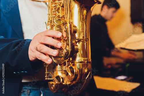 Photo Saxophone classical music instrument Saxophonist with alto sax closeup on black