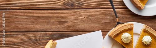 top view of pumpkin pie on wooden brown table, panoramic shot Wallpaper Mural