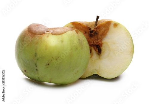 Valokuva  Rotten apple sliced in half isolated on white background