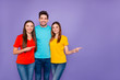 canvas print picture - Portrait of nice attractive lovely charming content cheerful cheery glad guys wearing colorful t-shirts denim pointing aside ad advert isolated over violet lilac background