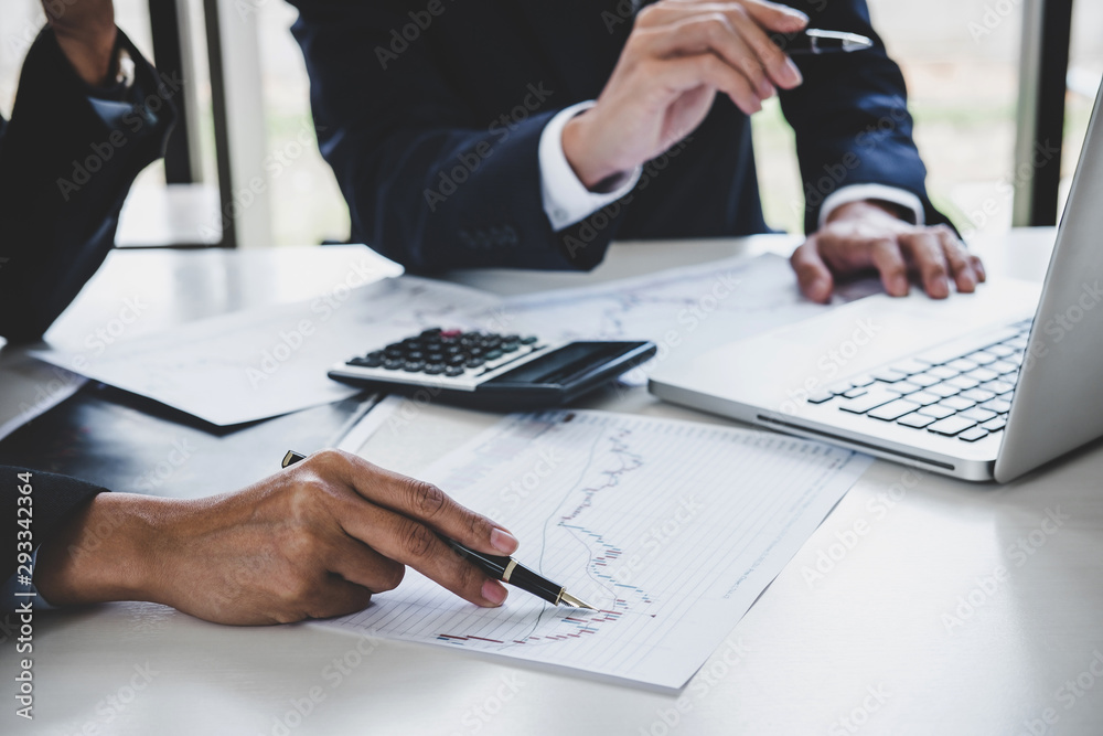 Fototapeta Business team investment working with computer and analysis graph stock market trading with stock chart data, business and technology concept
