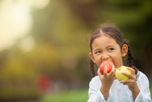 Child Eating Apple Little Girl Playing Peek A Boo Holding Fresh Ripe Apples