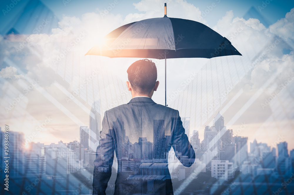 Fototapeta The double exposure image of the Businessmen are spreading umbrella during sunrise overlay with cityscape image. The concept of modern life, business, insurance and protection.