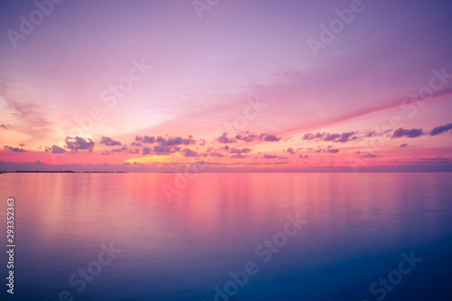 Zen sea sky sunset. Perfect sunset seascape. Vivid twilight sunset sky and motion blur of the sea under with long exposure effect.