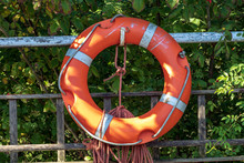 Life Saving Buoy Designed To Be Thrown To A Person In Water, To Provide Buoyancy And Prevent Drowning