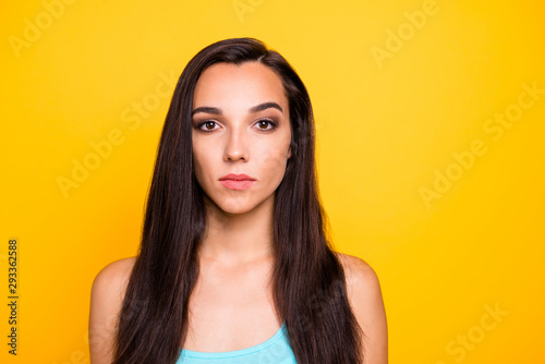 Close up photo of cute nice candid woman staring netrally into camera with face Fototapeta
