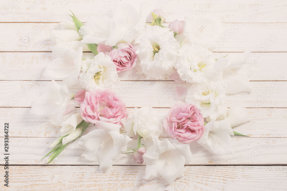Fototapeta pink and white flowers on white wooden background
