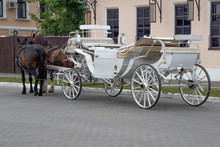 A White Horse-drawn Carriage With Two Horses, Waiting For Tourists On The Old Town Square At The City Of Kolomna, Russia.
