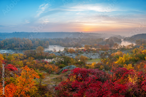 Foto auf Gartenposter Baume beautiful autumn landscape with colorful trees and foggy river on sunset