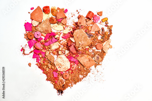 Fotografie, Tablou  Makeup Cosmetics eye shadow, blush and powder put together a shattered heart shape on white background