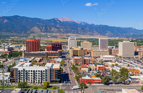 Aerial of downtown Colorado Springs with Pikes Peak in the background