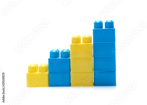 Colorful stacked toy plastic building blocks isolated on white background