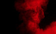 canvas print picture - Red color powder explosion on black background.Freeze motion of red dust particles splashing.