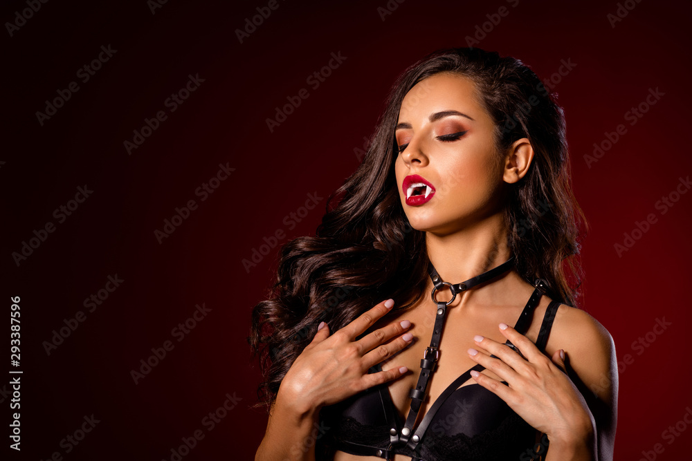 Fototapeta Close-up portrait of nice attractive stunning gorgeous chic adorable black brunette wavy-haired lady vamp goth enjoying role theme party isolated on dark red maroon burgundy marsala color background
