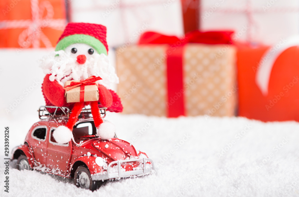 Fototapeta New year Santa delivering presents by car on background