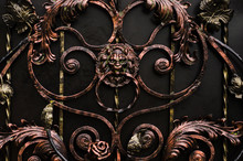 Forged Gate With A Door Handle In The Form Of A Lion's Head