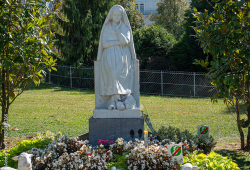 Statue of Bernadette of Lourdes with flowers Canvas Print
