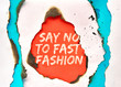 """canvas print picture Text """"Say no to fast fashion"""" in hole burned though color paper"""