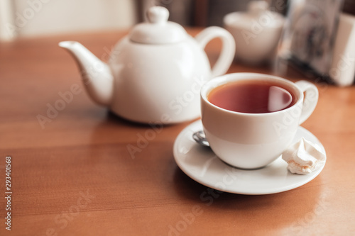 Hot tea in white cup