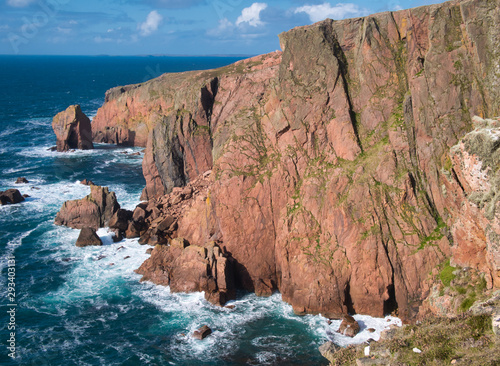 Photo Sea cliffs near North Ham on Muckle Roe, Shetland, UK - the rock is of the Muckle Roe Intrusion - granite, granophyric - igneous bedrock formed in the Devonian Period