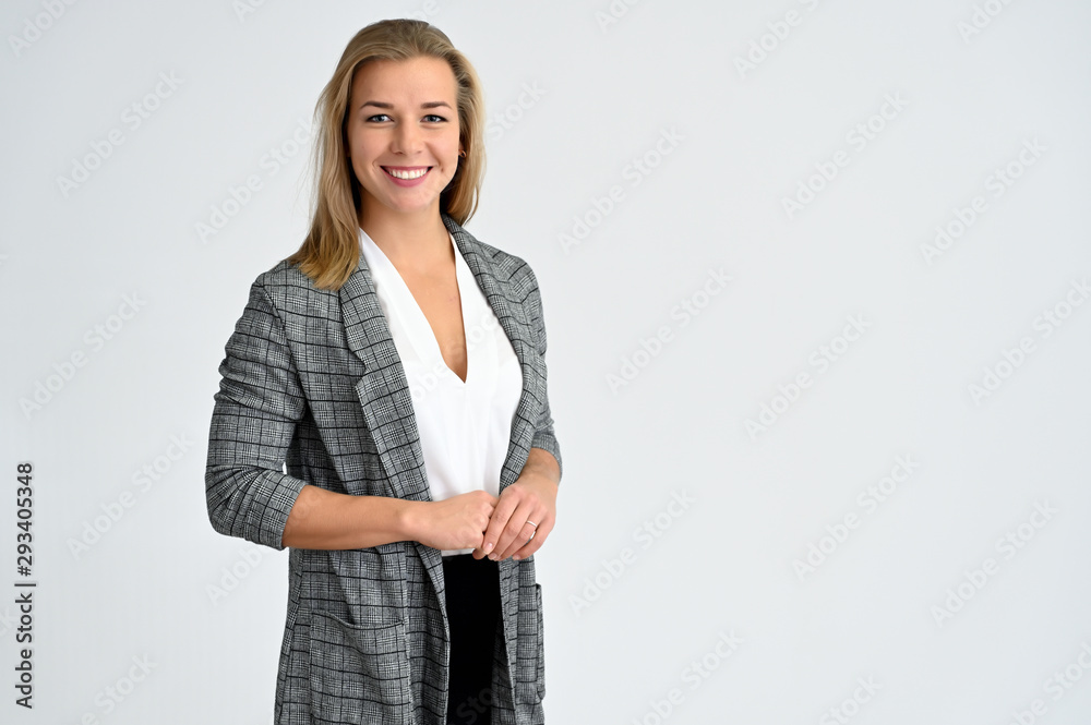 Fototapety, obrazy: Close-up portrait of a cute caucasian blonde female student girl in a gray jacket on a white background. Wide smile, happiness. It is in different poses.