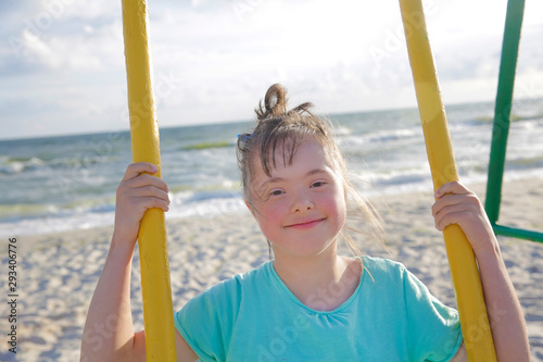 Little girl having fun on the swing Canvas Print