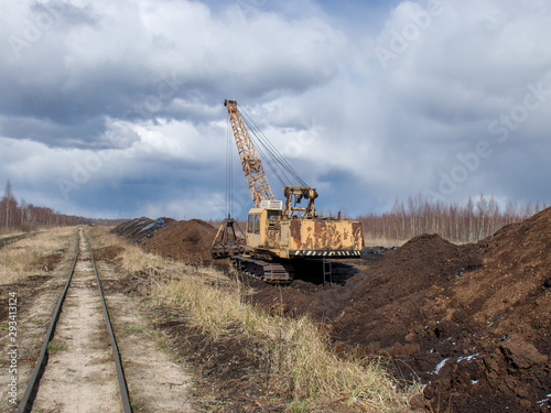 Fotobehang Lavendel Peat mining bog, Peat mining machinery