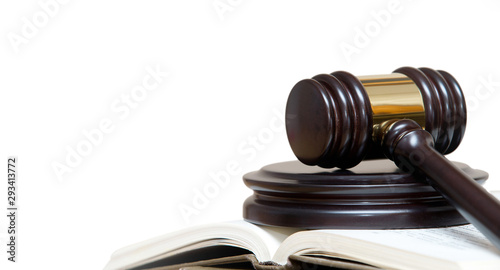 Obraz wooden gavel and books on wite background - fototapety do salonu