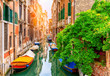 canvas print picture Narrow canal with boat and bridge in Venice, Italy. Architecture and landmark of Venice. Cozy cityscape of Venice.