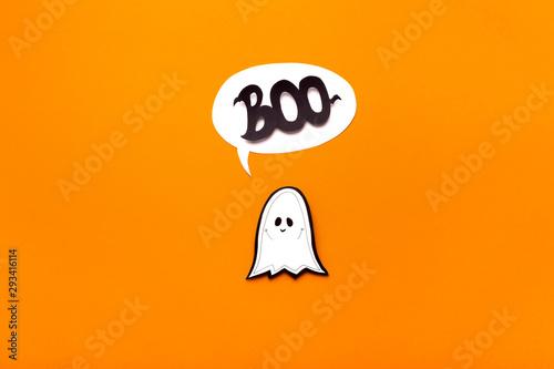 Fototapeta  Ghost kid saying boo on orange Halloween background