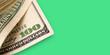 Leinwanddruck Bild - Close Up of Stack of dollars on green background