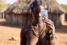 Mudimba Tribe Woman Showing A Picture Of Herself, Canhimei, Angola.