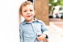 Portrait Of Young Toddler Boy With Brown Eyes In Urban Setting