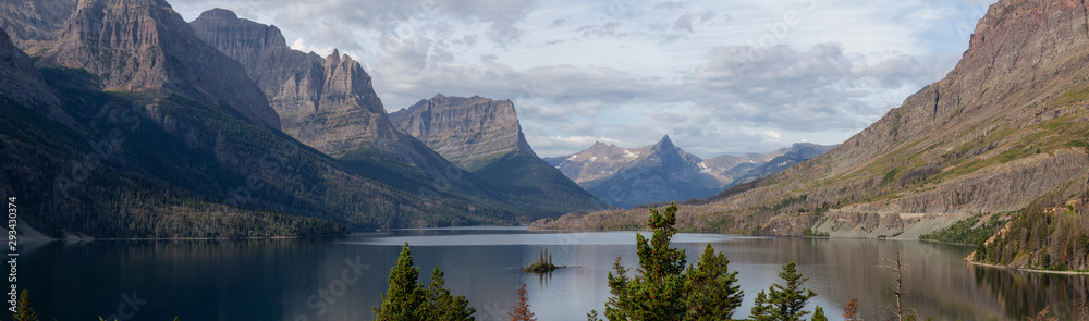 Fototapeta Beautiful Panoramic View of a Glacier Lake with American Rocky Mountain Landscape in the background during a Cloudy Summer Morning. Taken in Glacier National Park, Montana, United States.