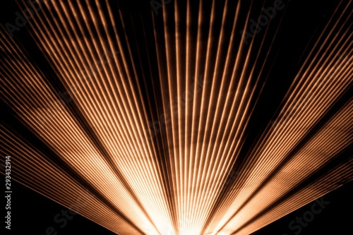 Orange laser show nightlife club and shining sparkling rays. Luxury entertainment in nightclub event, festival, concert or New Years Eve. Ray beams are symbol for science and universe research - 293432914