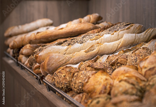 Photo sur Toile Pays d Afrique Variety of bread on the shelf. Freshly baked loaves