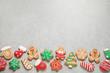 Leinwandbild Motiv Flat lay composition with tasty homemade Christmas cookies on grey table, space for text
