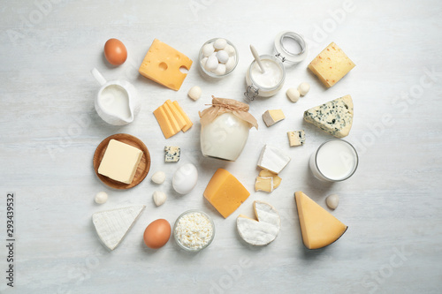 Cuadros en Lienzo Different delicious dairy products on white table, flat lay