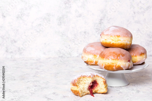 Traditional Polish donuts with frostng on light background Fototapet