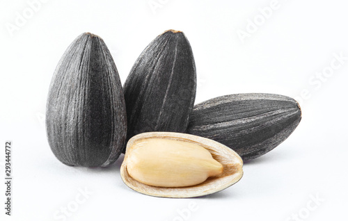 Obraz Close-up of delicious sunflower black seeds, isolated on white background - fototapety do salonu